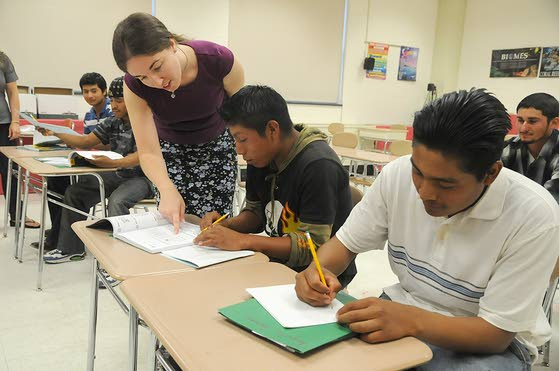 Teacher and adult students in an ESL classroom.