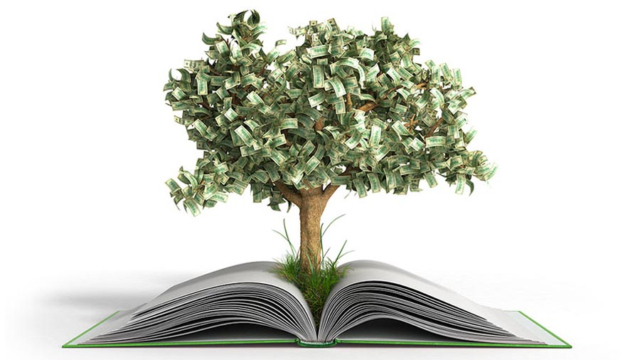 A tree with money for leaves grows out of an open book.