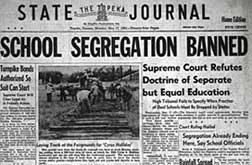 "Newspaper headline reads ""School Segregation Banned""."