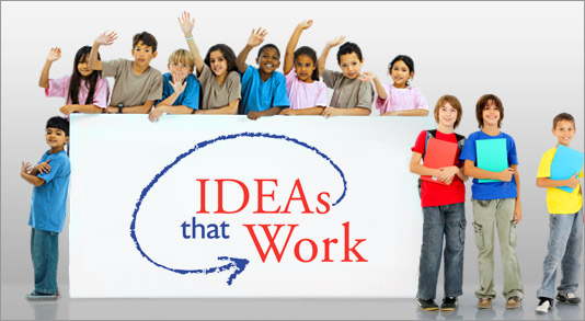 Several children hold a large sign that says Ideas that Work.