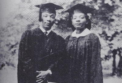 Martin Luther King Jr and his sister in cap and gown for college graduation.