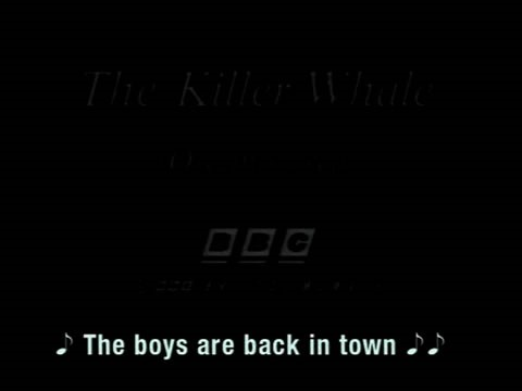 "Video still of dark screen. Caption says: (Musical note) The boys are back in town"" (musical notes)."